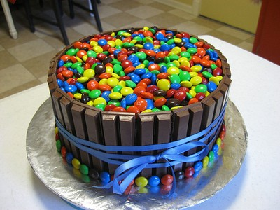 """M & M cake with KitKat """"frosting"""""""